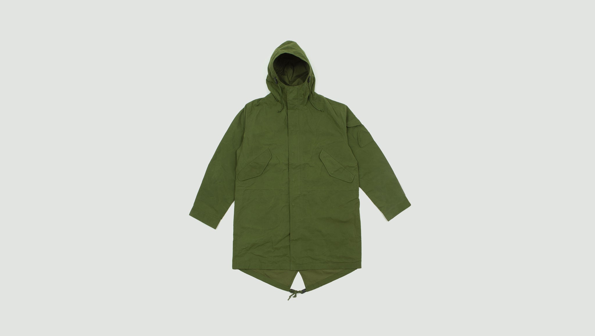 Universal Works. Parka scottish wax cotton green