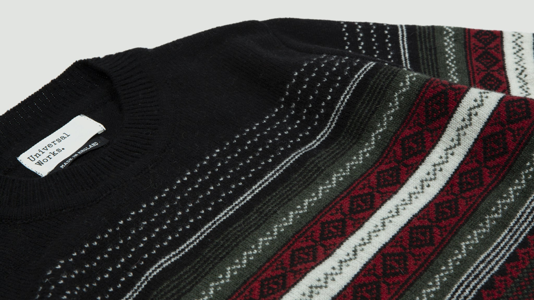 Universal Works. Crew neck fair isle mix black