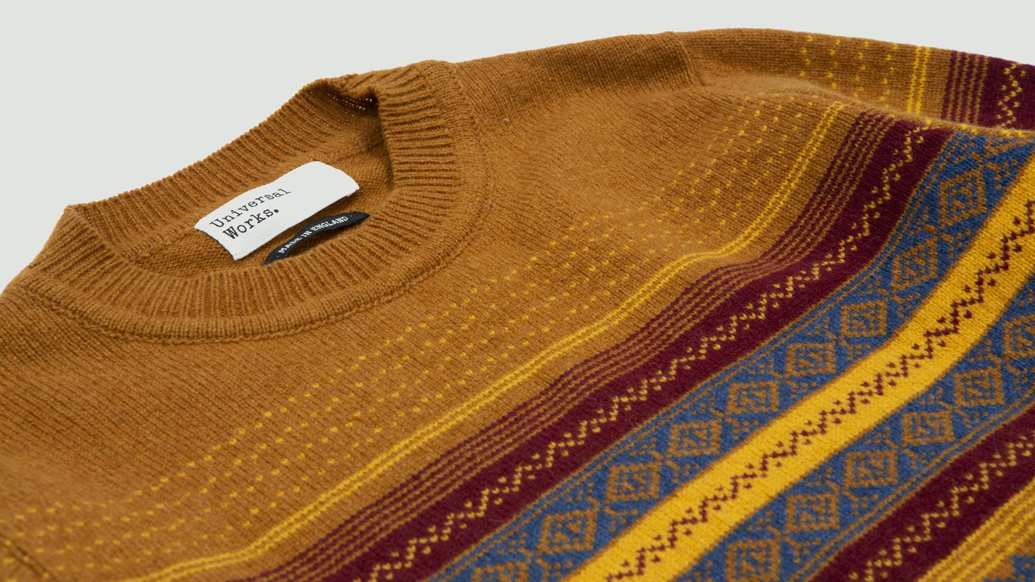 Universal Works. Crew neck fair isle mix mustard