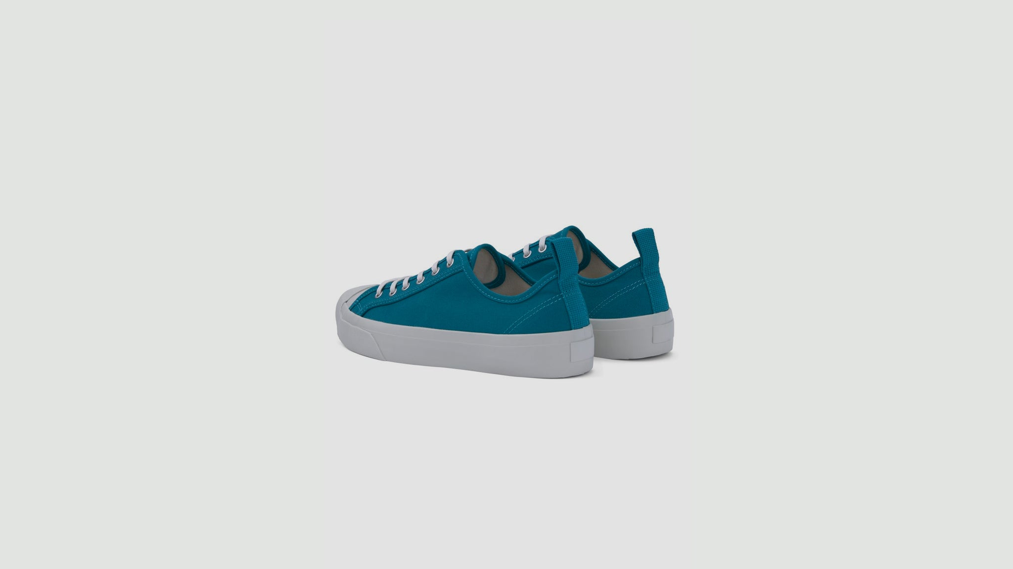 YMC. Wing Tip trainers teal