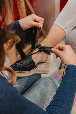 Lacing up traditional espadrilles in Barcelona