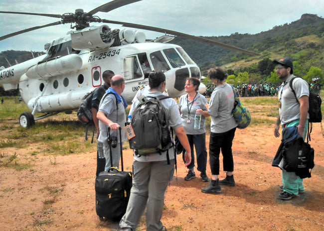 ISHI team with a UN helicopter in Sierra Leone