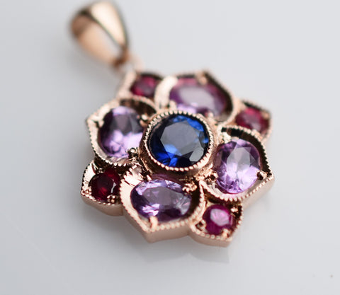 14k gold pendant with sapphires and rubies