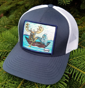 Moose and Owl in Canoe Trucker Hat