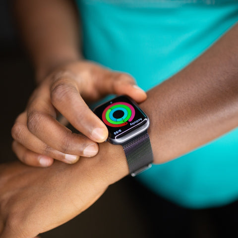 activity rings shown on apple watch on wrist