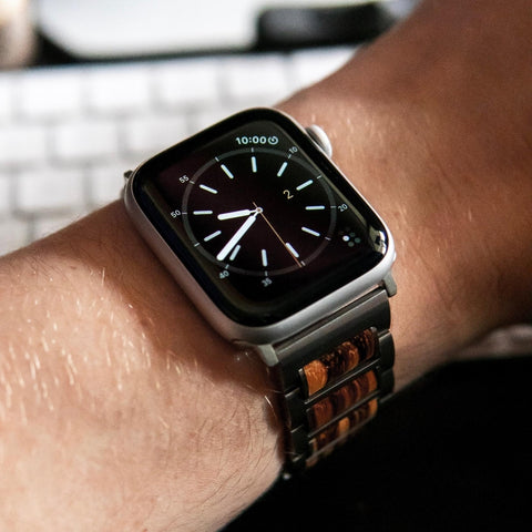 stainless steel wooden apple watch band on wrist