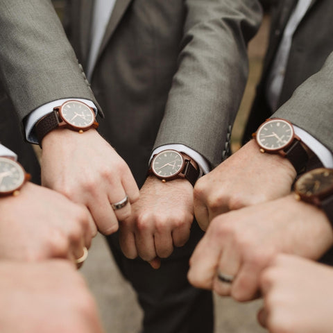 group of guys with hands showing watches in a circle