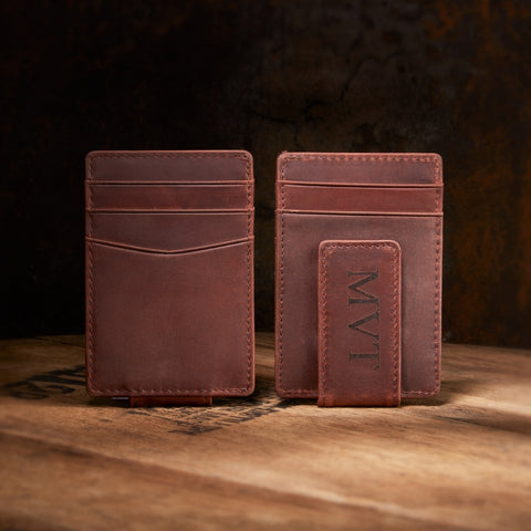 engraved leather money clip on whiskey barrel top