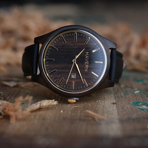 the benson ebony wood watch on a whiskey barrel