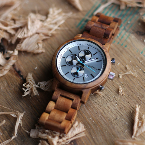 wooden watch lying on whiskey barrel