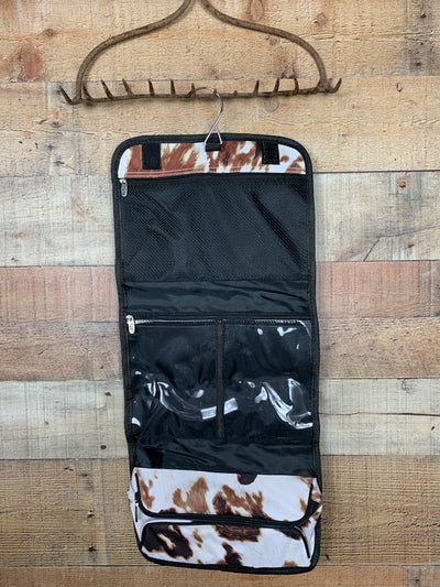 Cow Print Traveling Toiletry Bag
