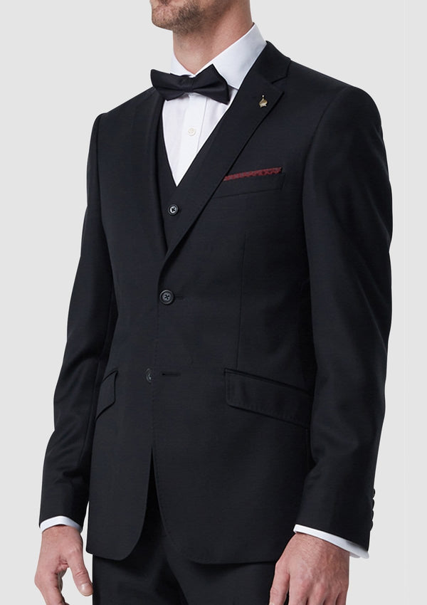 the wolf kanat black autograf mens suit vest layered with the autograf mens suit and a black bow tie