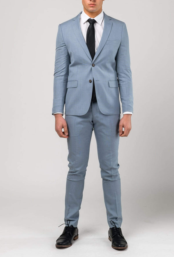 A full length view of a model wearing the Aston slim fit Brighton trouser in sky blue A0520191T