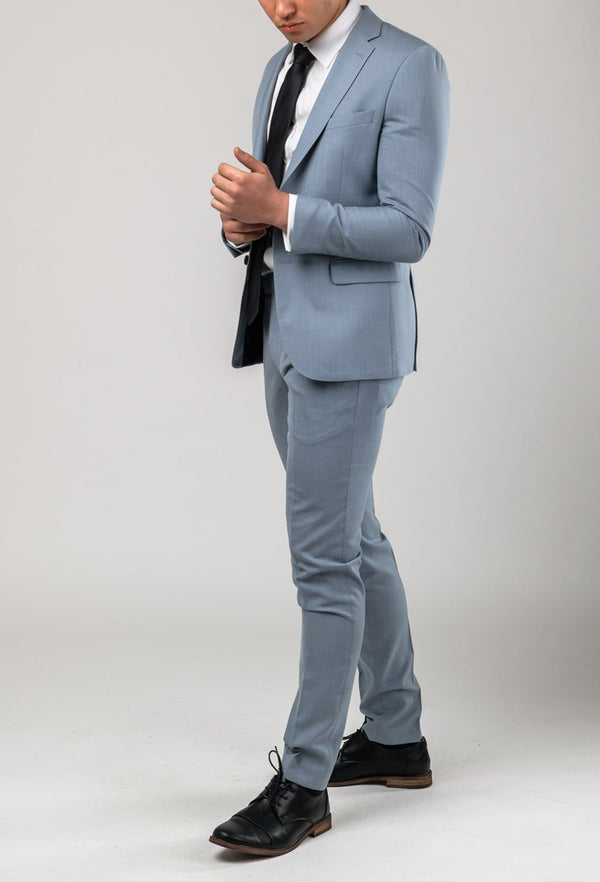 A side view picture of a model wearing the Aston slim fit brighton suit in sky blue A0520191S