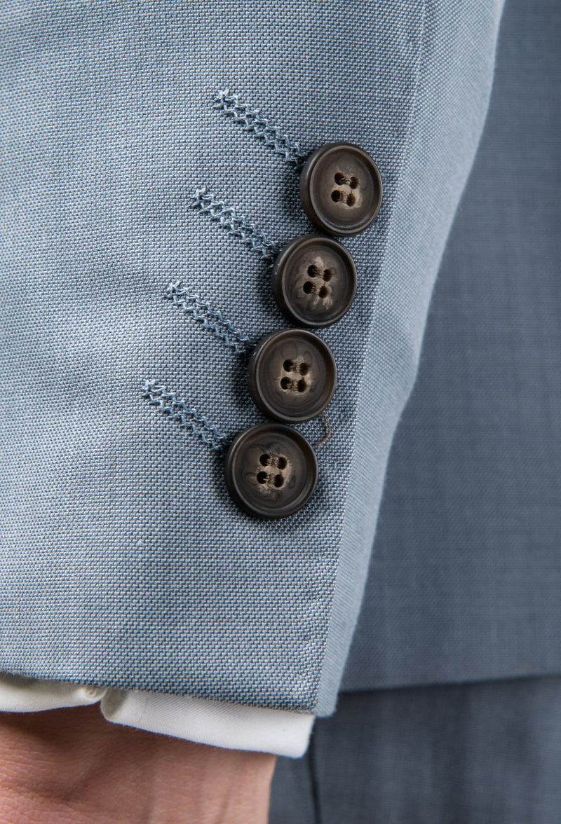 A close up view of the sleeve button detail on the Aston slim fit brighton suit in sky blue A0520191S