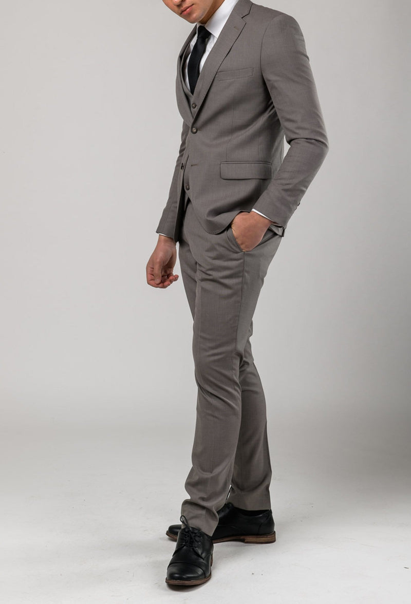 A full length side on view of the Aston man Brighton suit in taupe poly wool blend a0320194s
