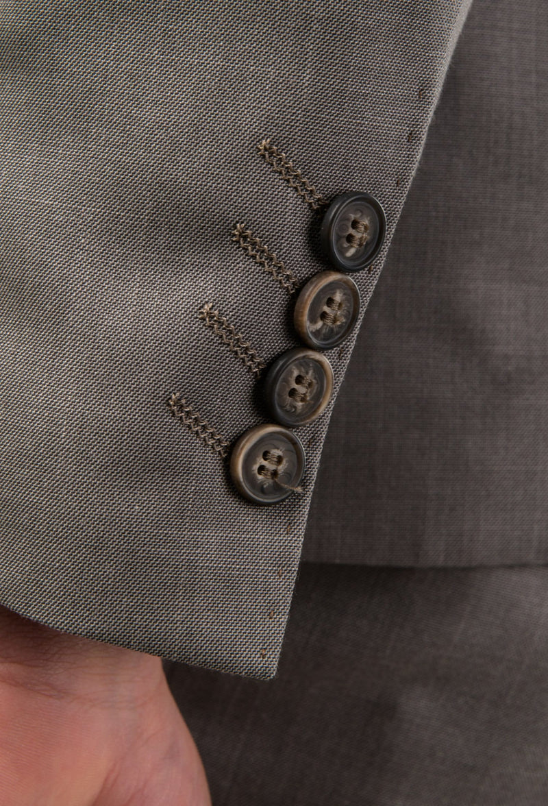 a close up view of the brown sleeve button details on the Aston man Brighton suit in taupe poly wool blend a0320194s