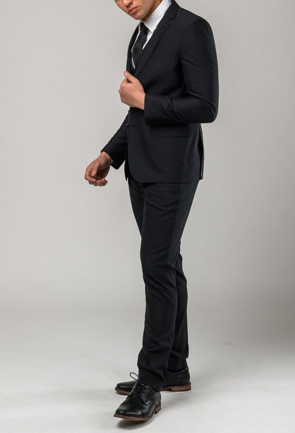 a side view of the Aston slim fit colton trouser in black pure wool A0137122T styled with the Colton suit jacket