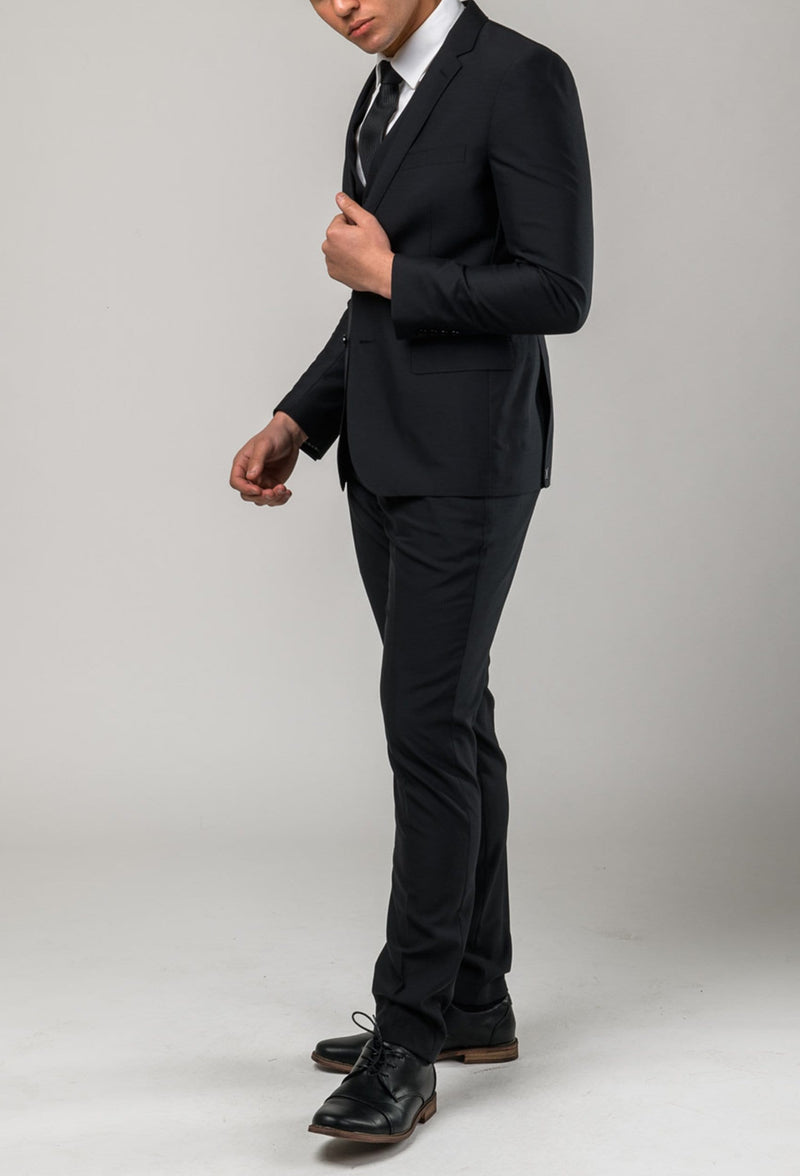 a side view of the Aston slim fit colton suit in black pure wool A0137122S