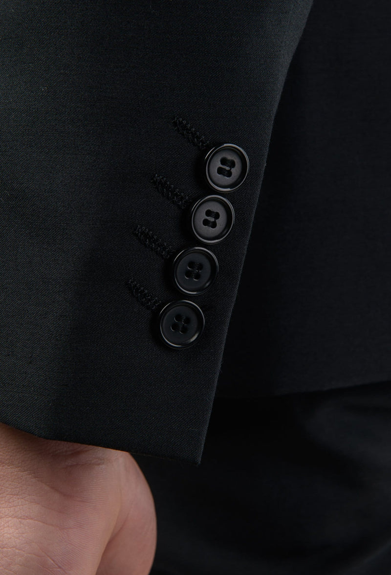 a close up of the sleeve button detailing of the Aston slim fit colton suit in black pure wool A0137122S