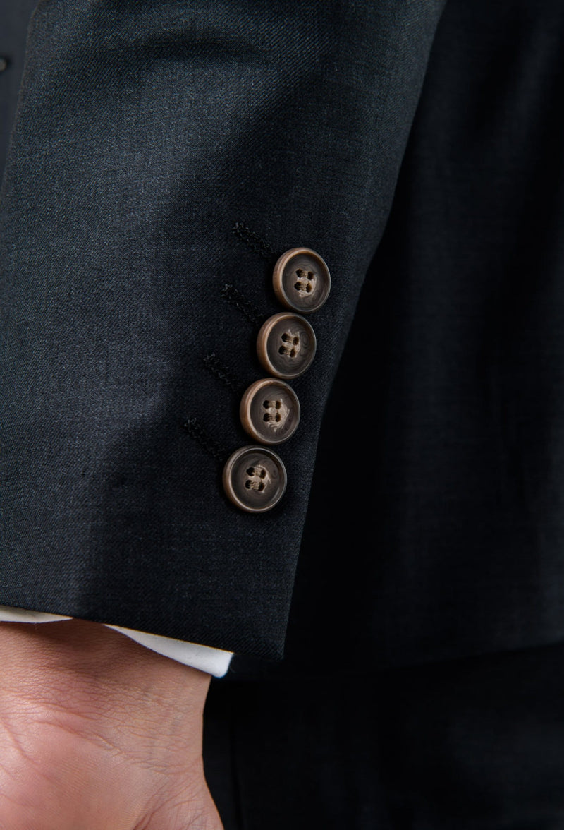a close up view of the sleeve button details on the Aston slim fit colton suit jacket in charcoal pure wool A0220172S