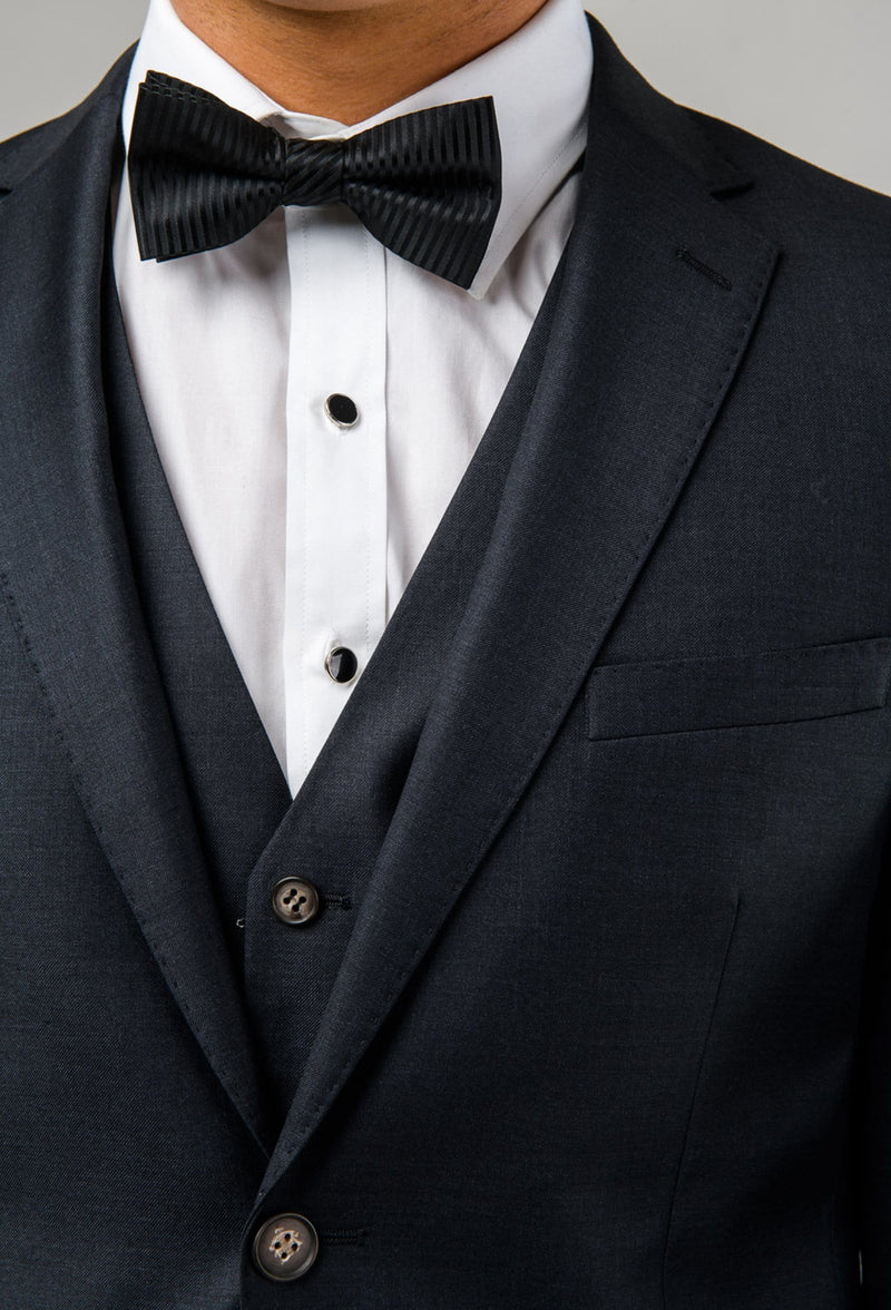 a close up view of the lapel detail and buttons on the Aston slim fit colton suit in charcoal pure wool A0220172S