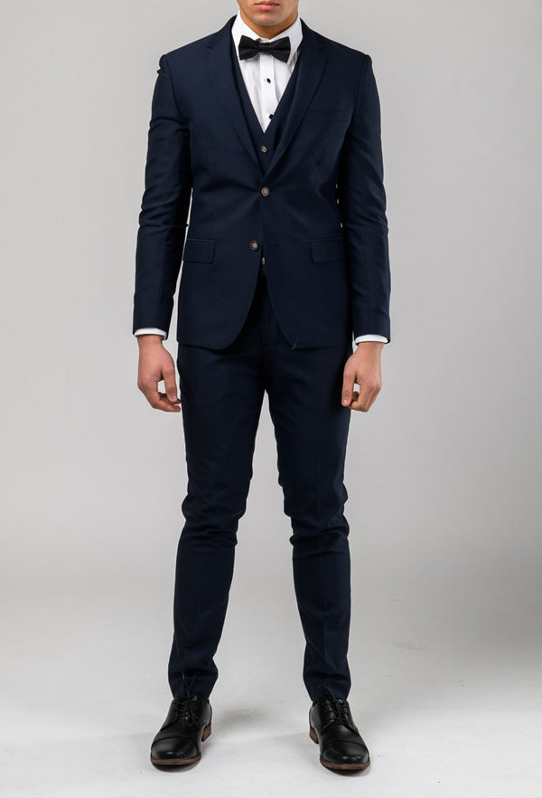 Aston slim fit colton suit in navy pure wool A0437162S full length styled with a white shirt and black bow tie
