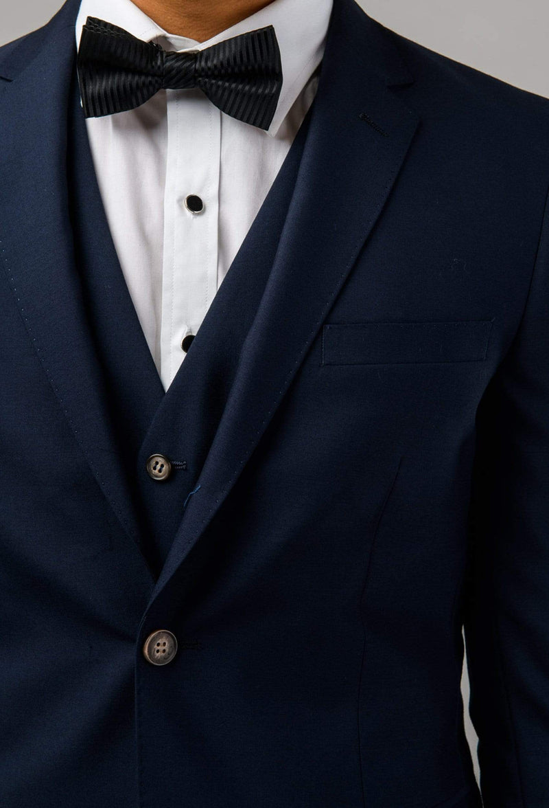 a close up view of the lapel and vest detail on the Aston slim fit colton suit in navy pure wool A0437162S