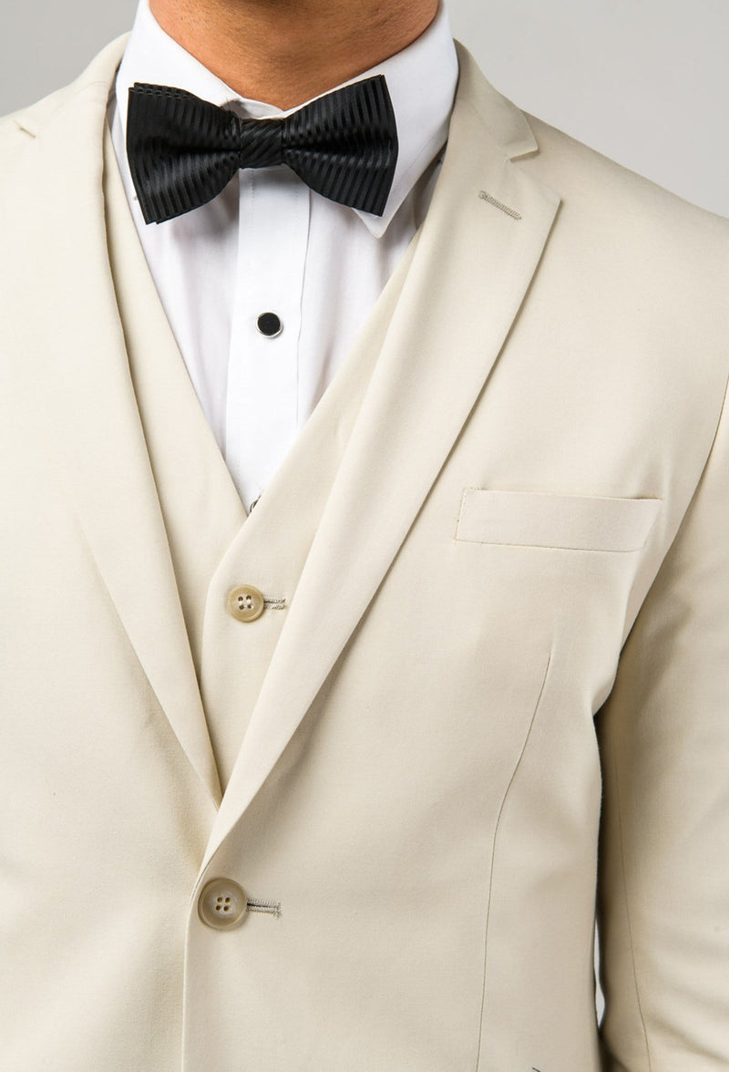 a close up view of the jacket lapel and vest details of the Aston slim fit lackhart suit in beige A099301S