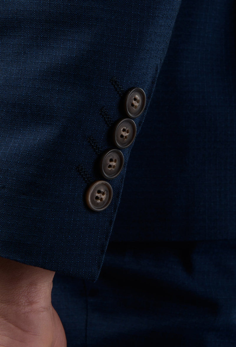 a close up view of the sleeve button detail on the Aston slim fit leon suit jacket in navy A042621S