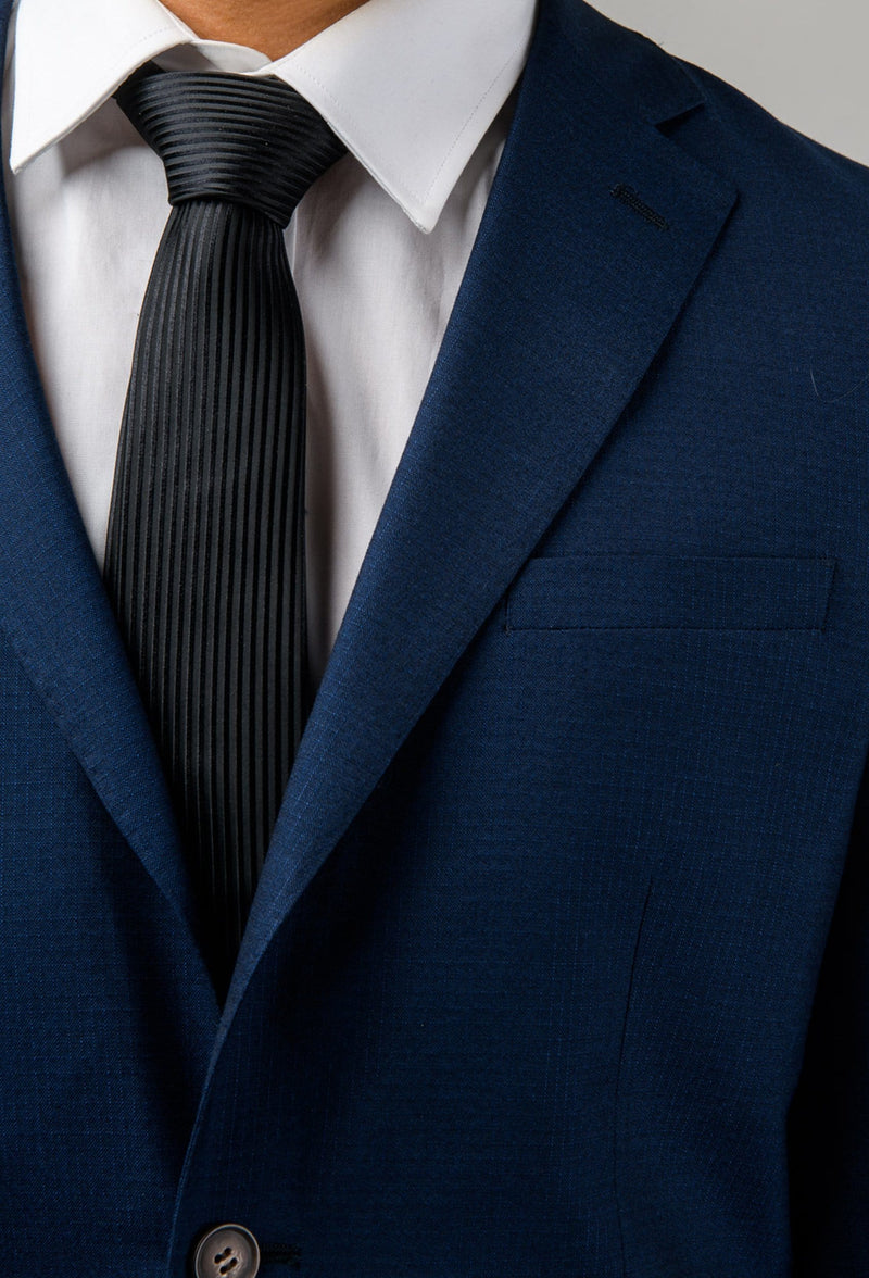 A close up view of the lapel detail on the a close up of the Aston slim fit leon suit in navy A042621S