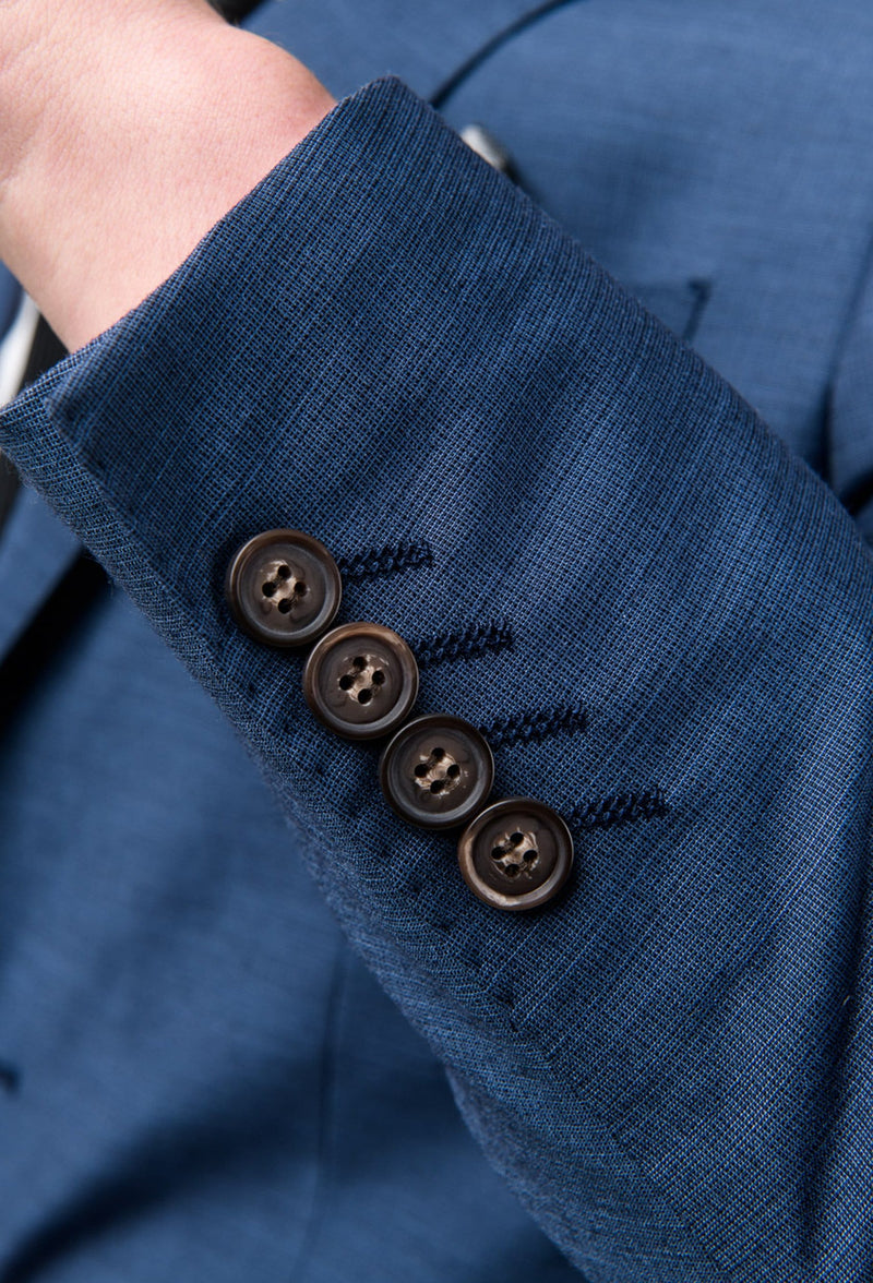 a close up picture of the four button detail on the aston slim fit leon suit jacket in slate A042682