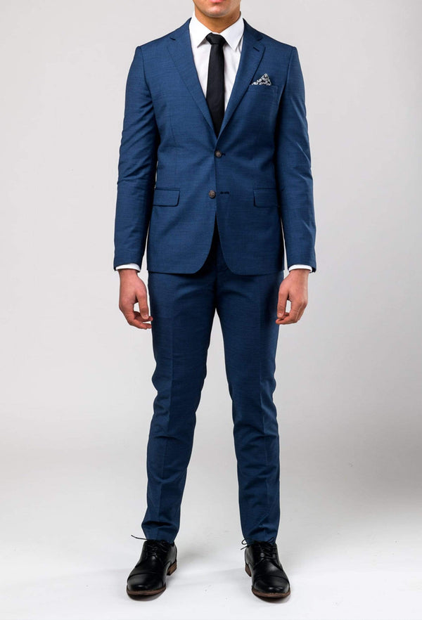 a model wears the aston leon slim fit trouser in blue A042682T styled with the matching jacket from the Leon suit