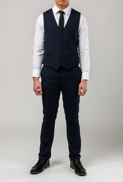 a front on view of the Aston slim fit moores vest in navy A049301V-NL styled with a white shirt and black tie