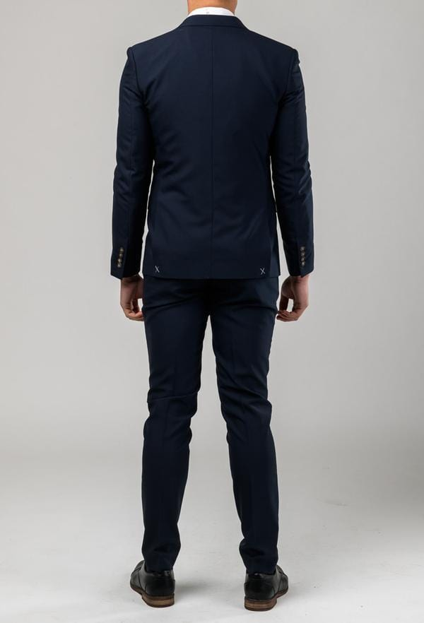 a rear view of the Aston slim fit moores suit in navy A049301S including the side vent at the back