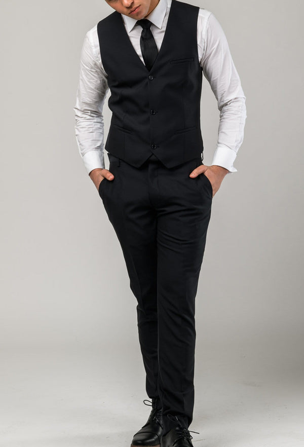 A front on view of a model wearing the Aston slim fit moores vest in black A019301V-NL