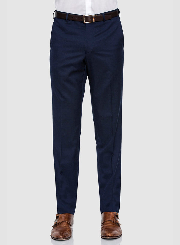 a picture of a model facing forward wearing the Cambridge classic fit interceptor trouser in dark blue navy pure wool F2800