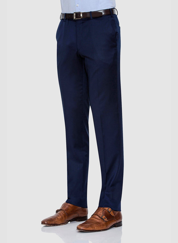 side view of a model wearing the Cambridge classic fit interceptor trouser in navy pure wool FCZ027
