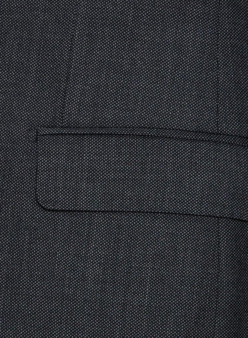 A close up view of the straight flap pocket detail of the jacket A closer view of a model wearing the Cambridge classic fit morse suit in grey pure wool FCC076