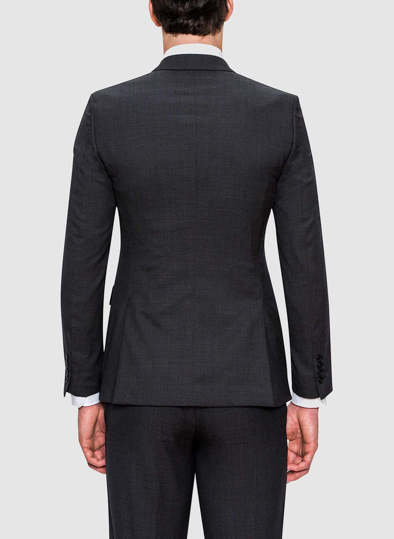 A back view of the A full view of a model wearing the Cambridge classic fit range suit in charcoal pure wool F2800