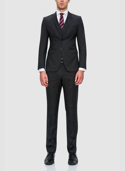 A full view of a model wearing the Cambridge classic fit range suit in charcoal pure wool F2800