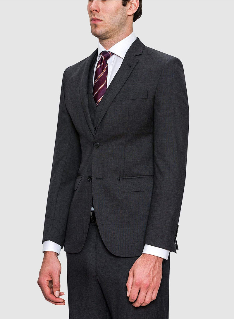 A side view of a model wearing the Cambridge classic fit range suit jacket in charcoal pure wool F2800
