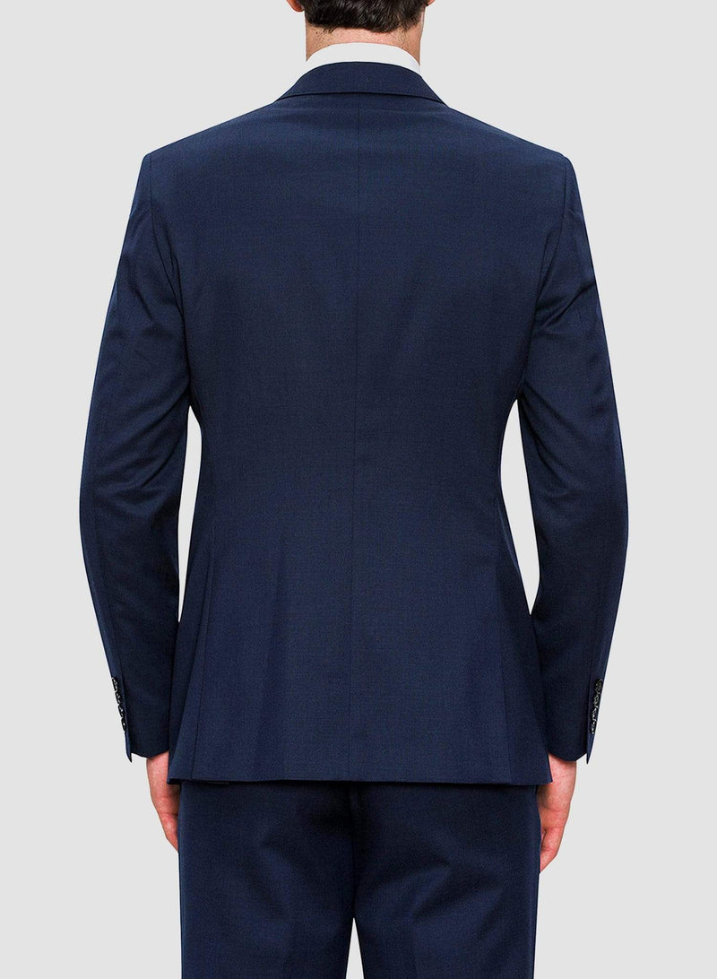 An image of the back of a model wearing a Cambridge classic fit range suit in dark blue navy pure wool F2800