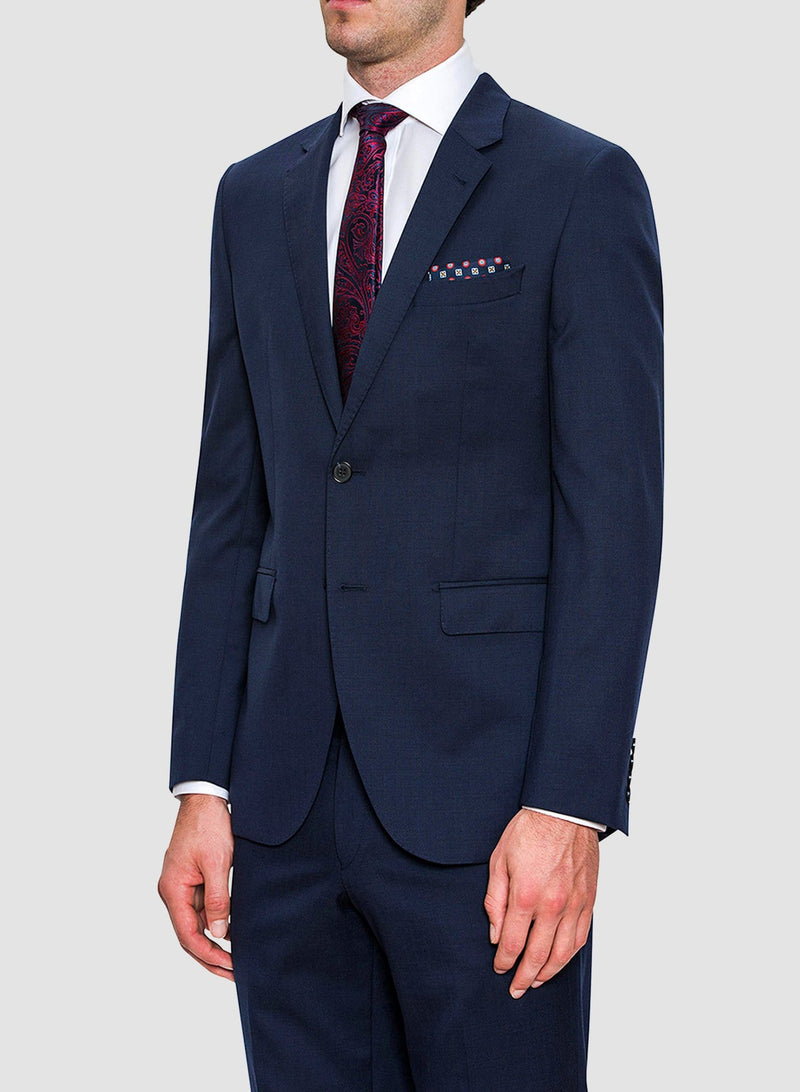 An image of a model wearing a Cambridge classic fit range suit in dark blue navy pure wool F2800