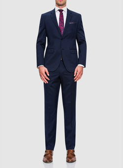 A full length image of a model wearing a Cambridge classic fit range suit in dark blue navy pure wool F2800