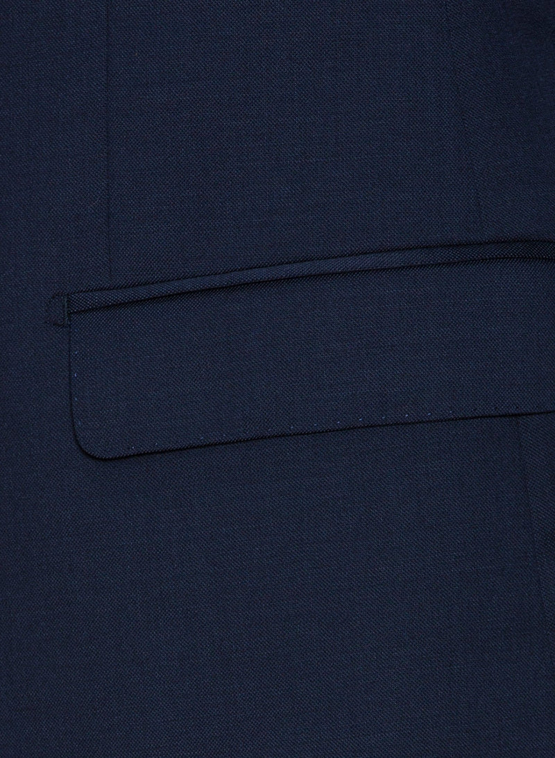 A close up view of the jacket pocket detailing on the Cambridge classic fit range suit in dark blue navy pure wool F2800