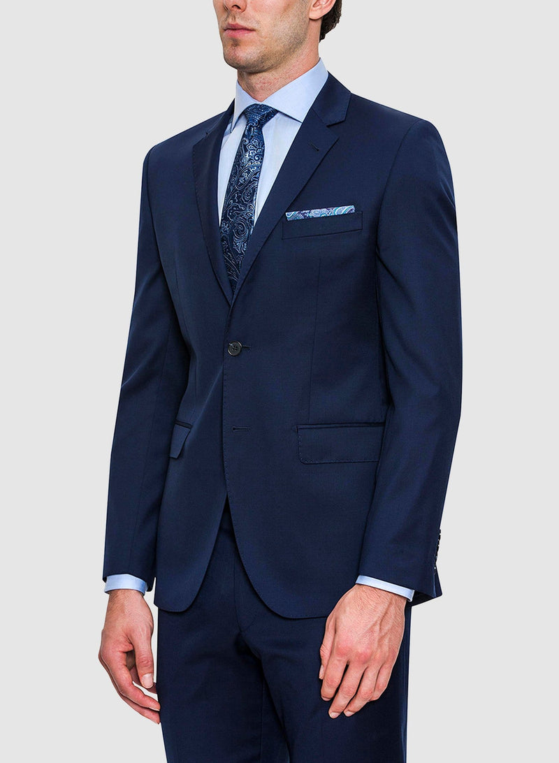 A side view of a model wearing the Cambridge classic fit range suit in navy pure wool FCZ027
