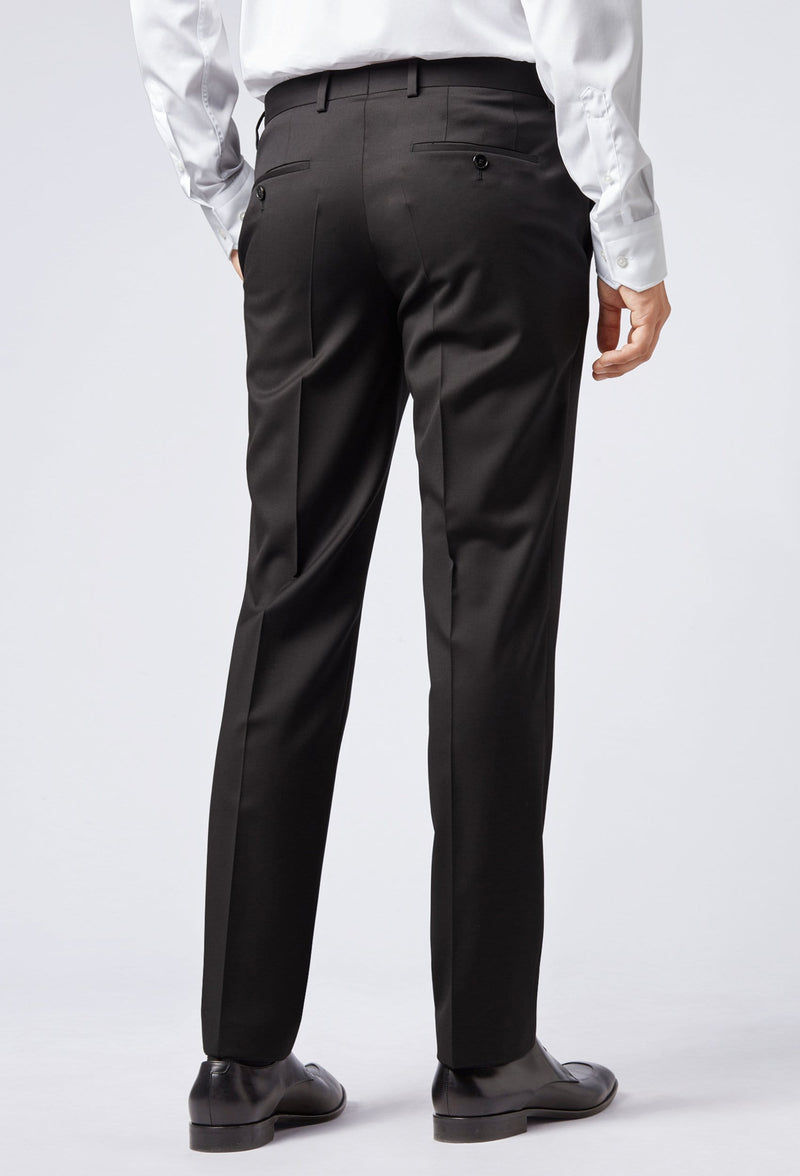 A rear view of a man wearing the Hugo Boss classic fit johnstons suit trouser in black