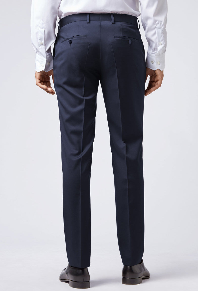 A reverse view of a man standing in the Hugo Boss classic fit lenon trouser in dark blue