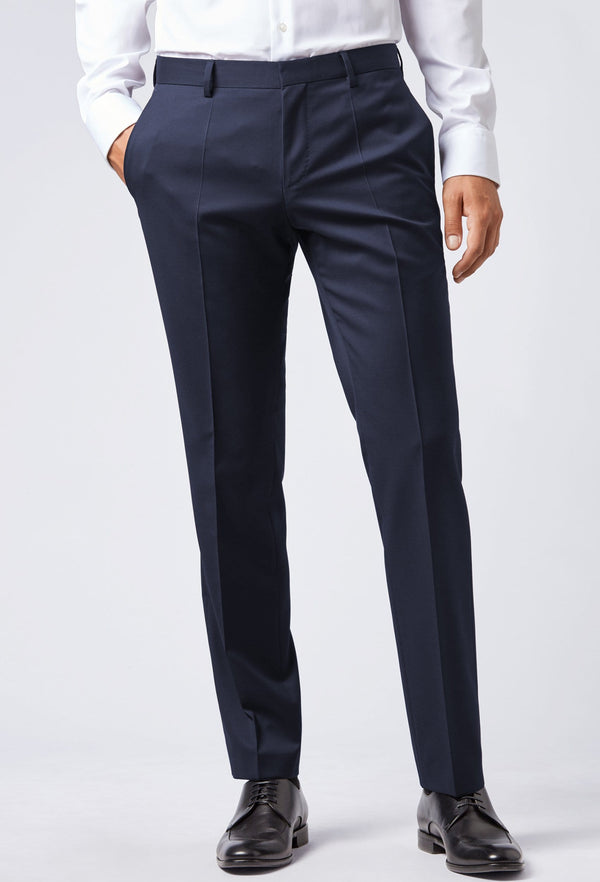 A front on view of a mans legs in the Hugo Boss classic fit johnstons suit trouser in dark blue